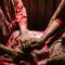 Asian Women Hold Hands, Pray